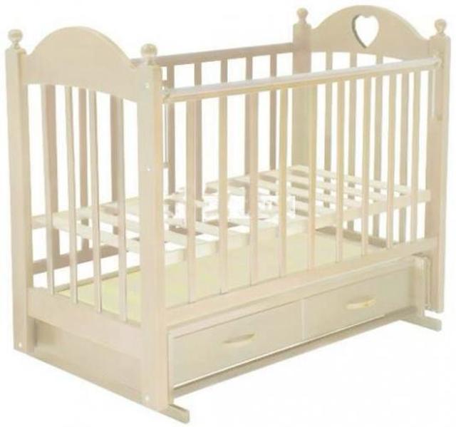Продаю детскую кроватку, механизм маятник с выдвижным ящиком для белья, цвет ваниль, в подарок матрас и бортики с постельным бельём нежно-желтого цвета и балдахин.