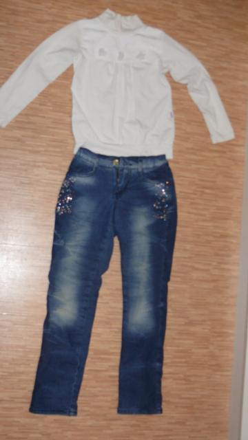 Две кофточки и двое утеплённых джинс. Состояние отличное. На девочку 6-7-8 лет