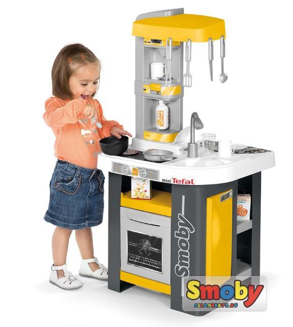 Описание Кухни Smoby Tefal Studio  Вспомните свое детство, то, как вы мечтали иметь маленький автомобиль, кухню или любые приспособления, которыми пользуются взрослые. Теперь у вас есть возможность, подарить своим детям то, о чем когда-то мечтали вы. Например, игрушечную электронную кухню с настоящими звуками приготовления еды. С такой игрушкой ваш малыш будет не просто доволен, а занят 24 часа в сутки и 7 дней в неделю.  В комплекте: - Раковина с краном (без воды) - Духовка - Холодильник - Кофемашина - Сода-машина - Аксессуары - Электронная плита Размер игрушки: 48,8 см х 47 см х 100 см Вес: 5,33 кг. Страна происхождения: Франция