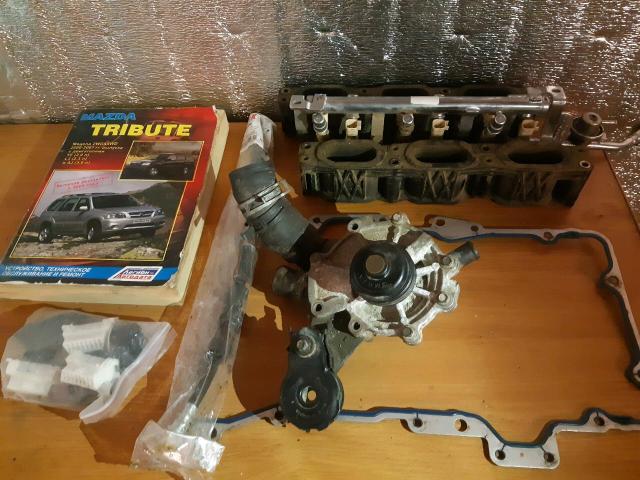 Книга FORD escape / MAZDA tribute  мотор aj: -помпа -тормозной шланг -топливная рейка с форсунками  бонусом фишки магнитолы и прокладка поддона. Желательно одним лотом, цена договорная, хорошая скидка.
