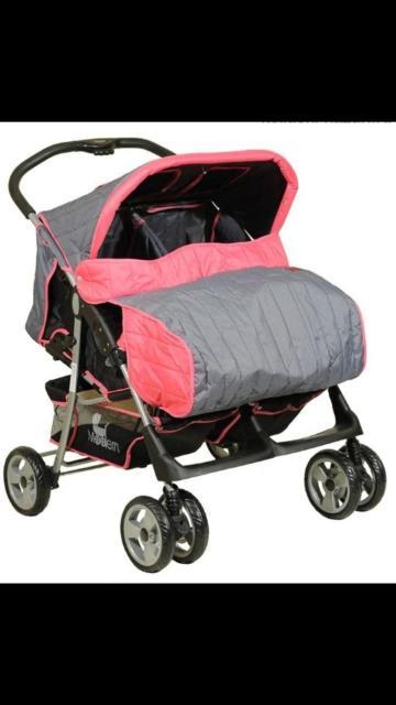 Универсальная прогулочная коляска зима-лето для двойни. Пять положения спинки, не зависит друг от друга, позволяют ребенку не только сидеть в коляске, но и уютно спать, складывается с ручки