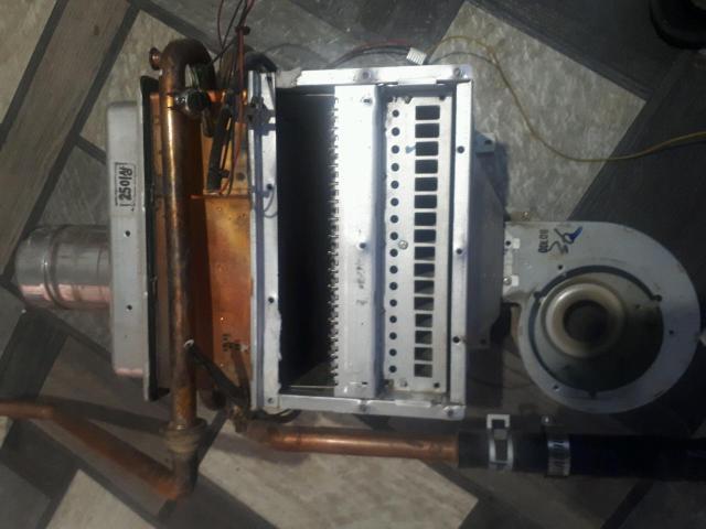 Продам Теплообменник газового котла риннай rb 367 rmf б.у и другие запчасти.