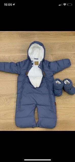 Mansita Комбинезон стильный и функциональный комбинезон для детей от 0 до 9 месяцев.Рекомендуемая температура для прогулок: от +10°С до -10°С, в зависимости от остальной одежды. Можно использовать на выписку, в автолюльку, люльку, прогулочный блок и санки.